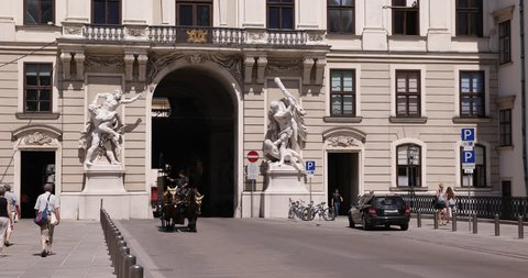 VIENNA, AUSTRIA - SEPTEMBER 15, 2014 Vienna Busy Old Town Streets Hofburg Imperial Palace Fiacres Pass People Walk ( Ultra High Definition, UltraHD, Ultra HD, UHD, 4K, 2160P, 4096x2160 )