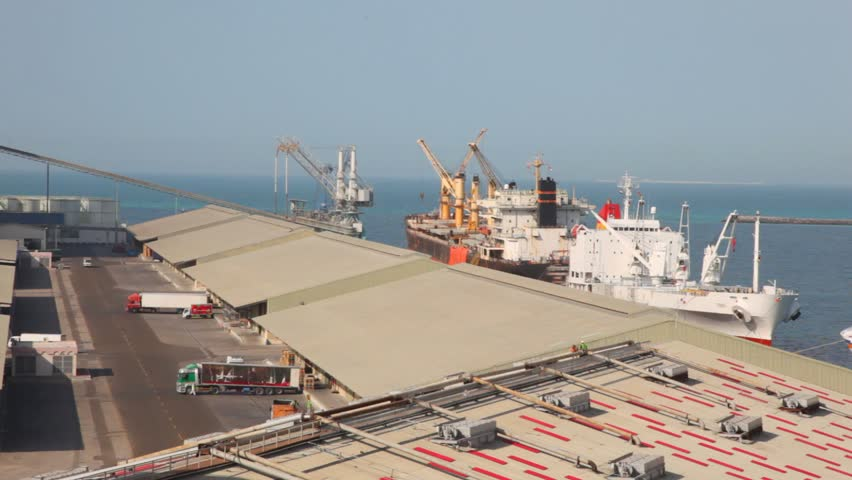 trucks and ship in seaport during shipment in Abu Dhabi, UAE