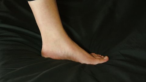 Woman Massaging Her Ankle With A Numbing Cream, Ankle Pain, Injury, Rheumatism