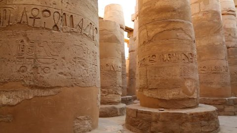 columns in karnak temple with ancient egypt hieroglyphics - pan view