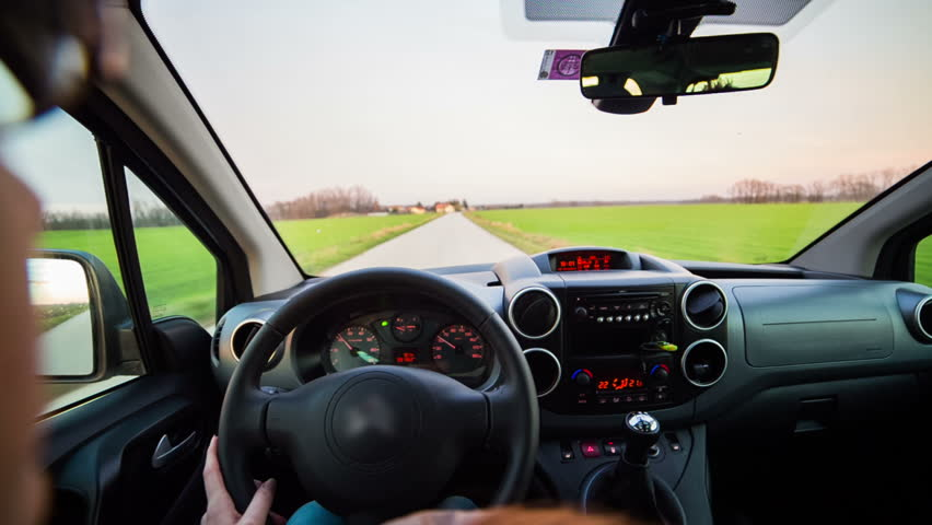 Woman driving car vehicle over shoulder view. First personal view of driving car vehicle. | Shutterstock HD Video #8623966