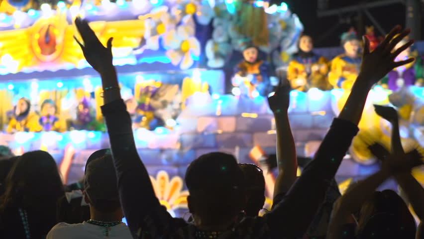 NEW ORLEANS, LA - MARCH 1:Crowd with hands in air during Endymion parade on March 1, 2014, in New Orleans, Louisiana.