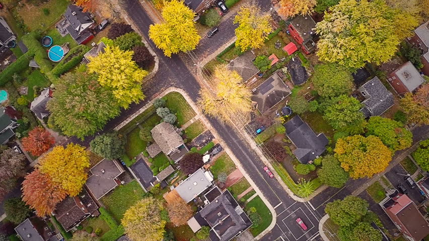 Top Suburban View of Montreal and beautiful Trees during a Cloudy Autumn day