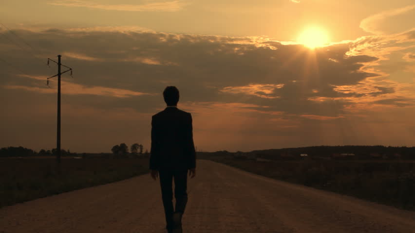Man walking down the road in the evening, way of life