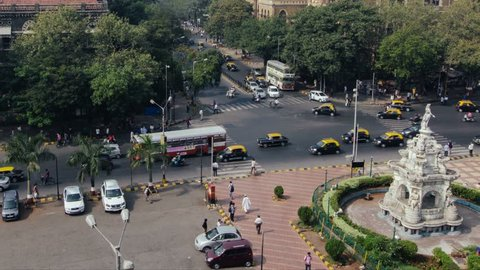 Timelapse of traffic at South Mumbai near Churchgate Station (earlier known as Victoria Terminus), Traffic & People at flora fountain (British Architecture) -  India  4k HQ