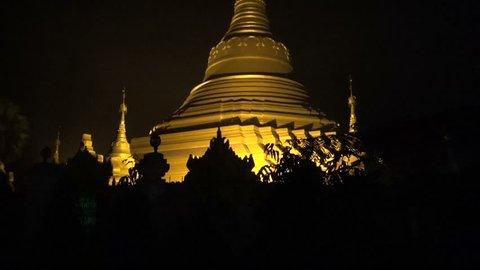 golden asia buddhists stupa temple in Kushinagar at night, India