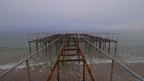 Foggy ocean wave stormy old pier. 60 fps slow motion