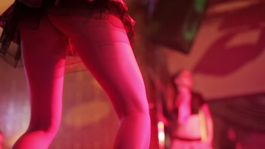 Girl dance gogo in nightclub. Sexy legs high heels.
