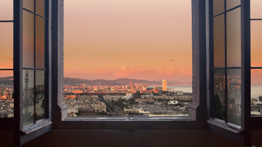 barcelona cityscape as seen from behind a window day to night timelapse at the sunset to night city lighting up panorama traffic rushing 4k #8781409