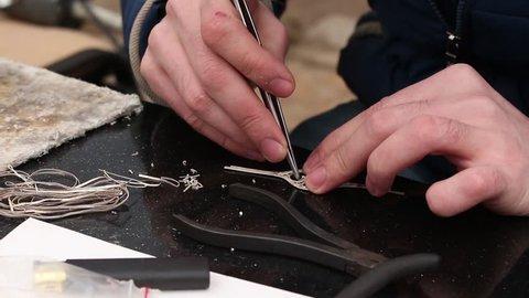 Filigree jeweler's working hands