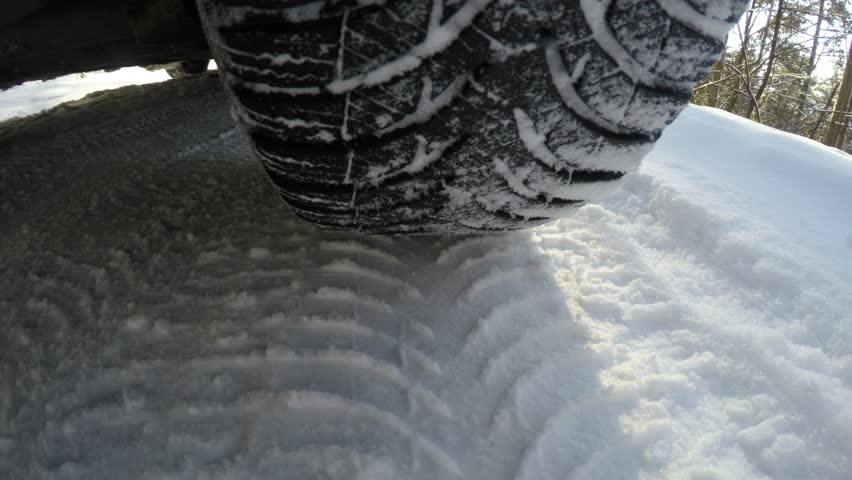 In the back of the cars wheel, winter road
