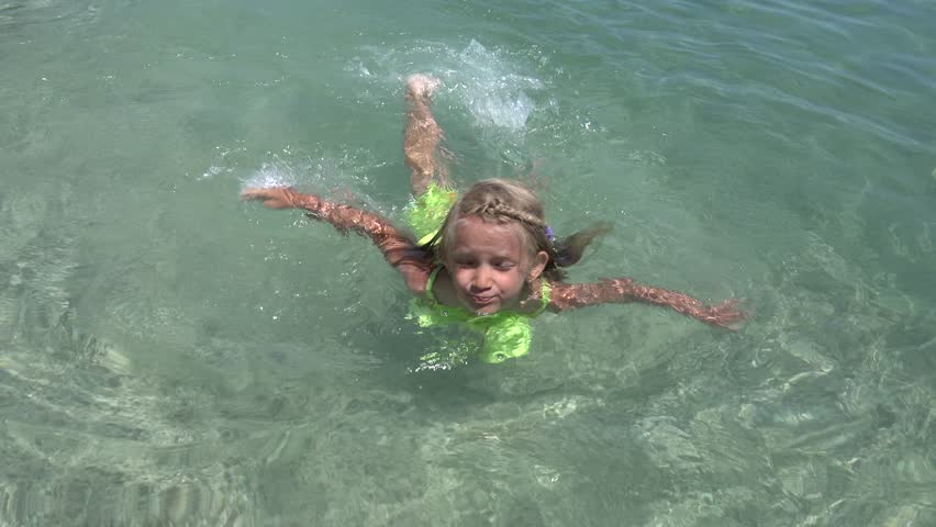Ultra Hd 4K Little Girl In Safety Belt Swimming At -5962
