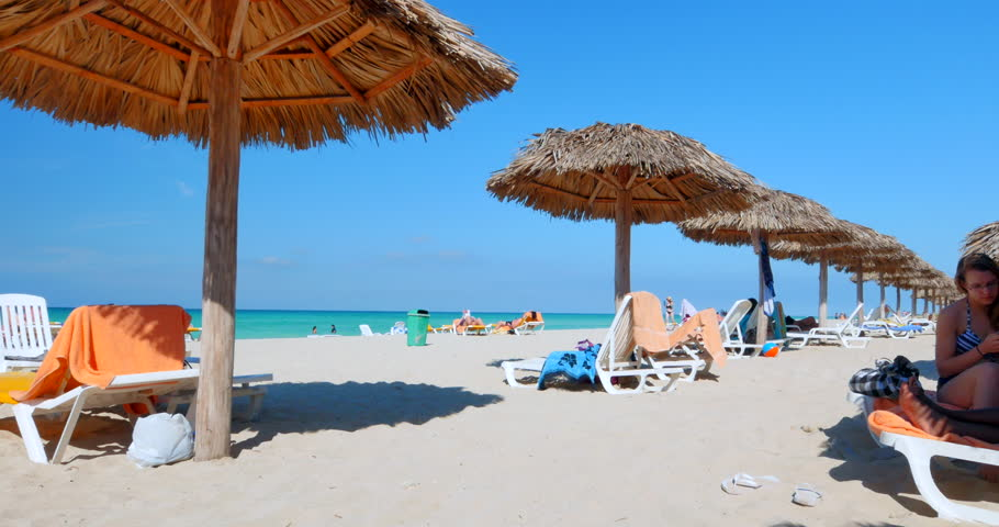 Video Ultrahd Tourists Rest In The Shade Of Beach Umbrellas On