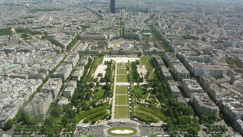 View of cityscape of Paris, Ile de France, France with major attractions of Paris - Champ de Mars, Tour Montparnasse, Hotel National des Invalides - tilt down