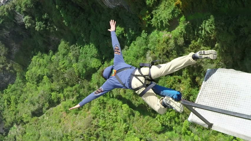 San Francisco bridge jumping , Banos de Agua Santa, Ecuador, wide angle slow motion | Shutterstock HD Video #8888230