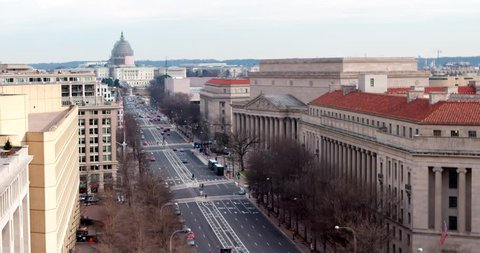 Super wide US Capitol and Pennsylvania Avenue Winter January 2015 scaffolded US Capitol dome with FBI Building on the left and The National Archives on the right.
