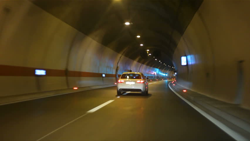 Car driving on highway tunnel