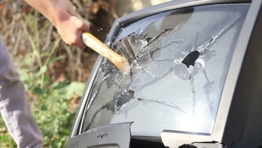 Child smashing TV with hammer