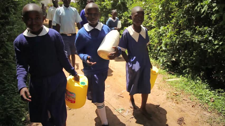 KAKAMEGA, KENYA - October 7th, 2014: Unidentified school children collect drinking water in Kakamega, Kenya. (For editorial use only.) | Shutterstock HD Video #8932879