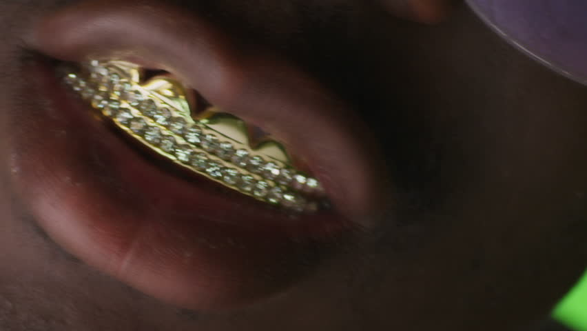 Gold teeth. Grills, grillz. RAP style. Golden teeth. African black man.On green screen. Shot on RED EPIC Cinema Camera.