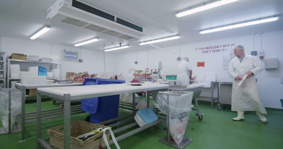 4K Group of butchers working in a fresh meat processing factory | Shutterstock HD Video #8953399