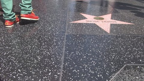 LOS ANGELES - USA, APRIL 2, 2013, POV Point of view of pedestrian people feet on walk of fame by day