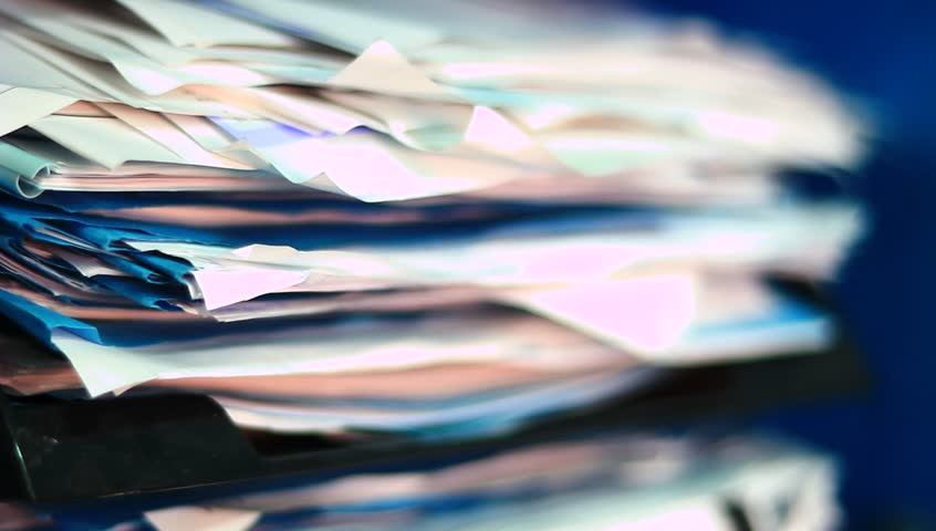 A pile of documents and office paper.