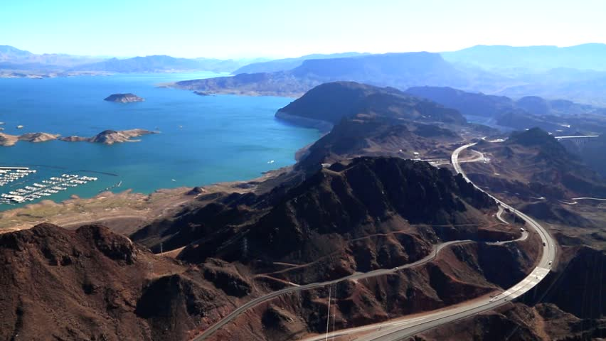 HD Aerial video of Lake Mead and the Highway 93 cutting the beautiful landscape in Nevada, USA. Did Use the Tyler Mount  stabilizer with the camera so the image stay stable.   Shutterstock HD Video #8978716