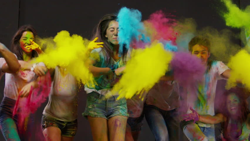 Colorful holi. Beautiful Youth. Holi festival of colorful kicks. Slow Motion. Shot on RED EPIC Cinema Camera 300 fps.   Shutterstock HD Video #9002773