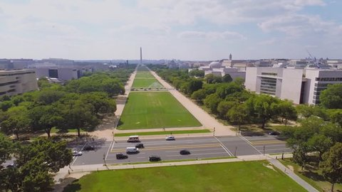 City traffic on 3rd Street across National Mall with Washington Monument, National Gallery of Art, Museum of American Indian at summer sunny day in Washington DC. Aerial view