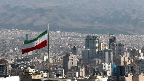 TEHRAN, IRAN JANUARY 2015: Iranian flag in the middle of Tehran city.