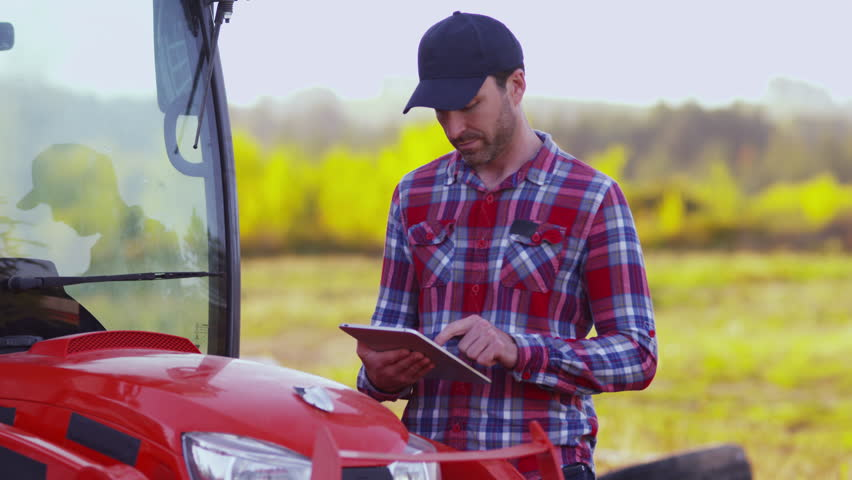 Farmer using digital tablet | Shutterstock HD Video #9033232