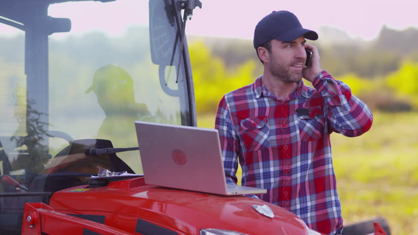 Farmer using laptop computer and cell phone | Shutterstock HD Video #9033925