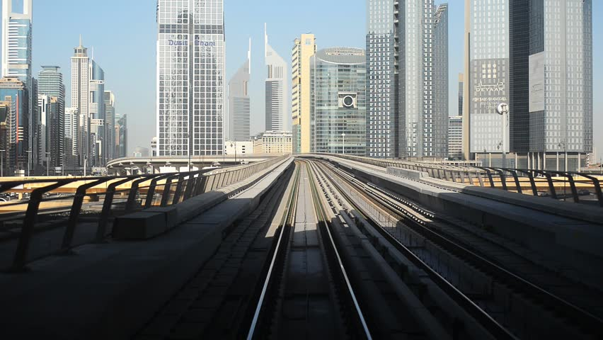 Dubai, United Arab Emirates - 13 December 2013: journey on the modern driverless Dubai elevated Rail Metro System, running alongside the Sheikh Zayed Rd. | Shutterstock HD Video #9043189