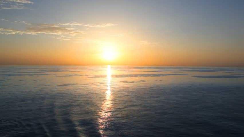 sunset on waving sea, view from top deck of moving cruiser