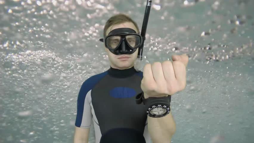 Diving sign- divemaster  shows sing  ASK QUASTIONS  ,also a available on the green screen all of diving sings from course (open water diver) 2  of 11