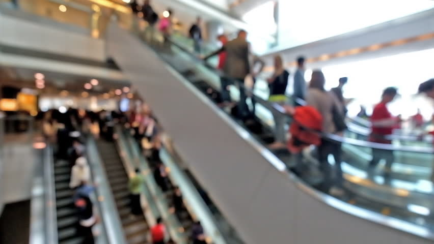 people on escalators. people on moving escalators at modern shopping mall, hong kong. blur effect, unrecognizable stock footage video 9118559 | shutterstock a