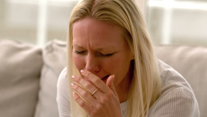 Image result for lady crying with tissue in hand