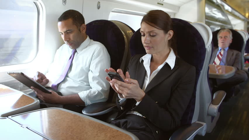 Businessman using tablet computer whilst female colleague talks on mobile phone.Shot on Sony FS700 in PAL format at a frame rate of 25fps | Shutterstock HD Video #9155129