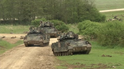 CIRCA 2010s - M 1 Abrams tank moves along a road in Albania.