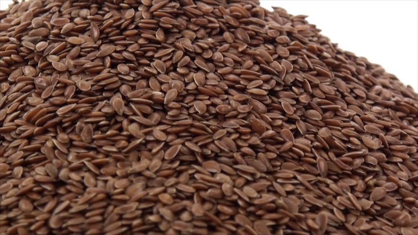 Vertical pan of flax seeds on white background 4. This video was shoot using custom light set up with additional custom build underneath light system to eliminate shadows. | Shutterstock HD Video #9157589