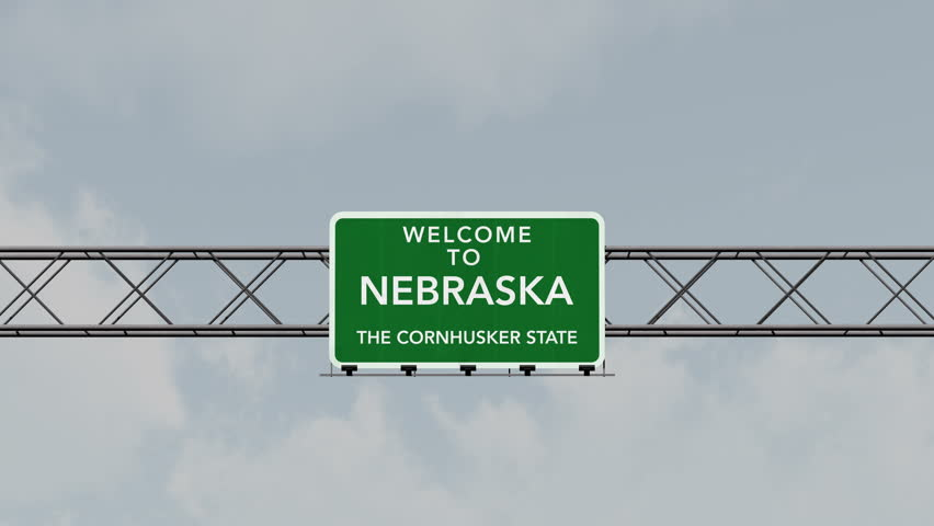 4K Passing under Welcome to Nebraska State USA Interstate Highway Sign with Matte Photo Realistic 3D Animation