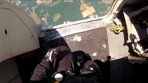 CIRCA 2010s - POV Go Pro skydiving footage of the U.S. Army Golden Knights parachuting team.