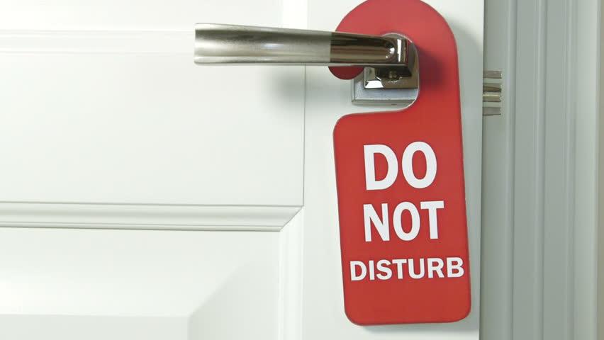 Door hanger do not disturb on handle of a hotel room