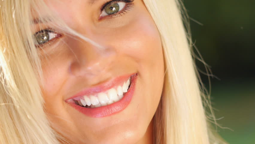 Young beautiful caucasian female model with healthy teeth.