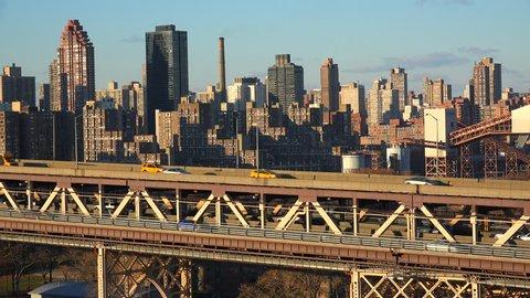 NEW YORK CITY - CIRCA 2015 - Traffic moves across the Queensboro Bridge with the New York skyline background.