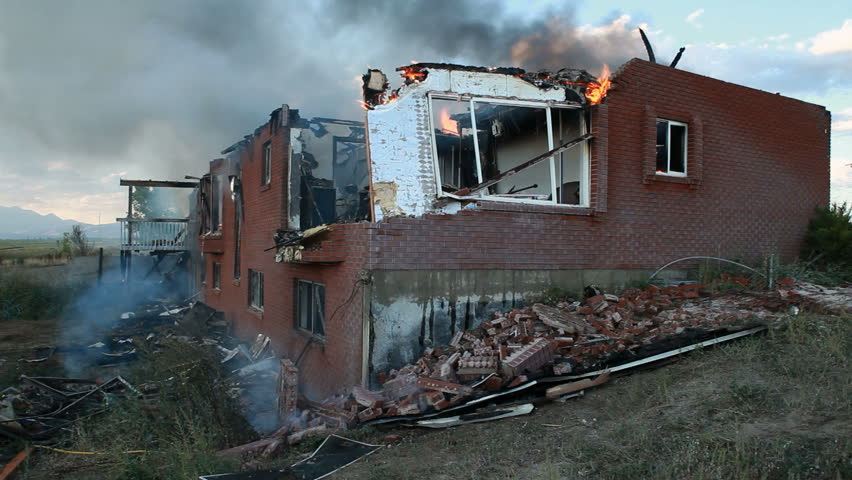 House Burning Through Collapsed Door Windows And Wall