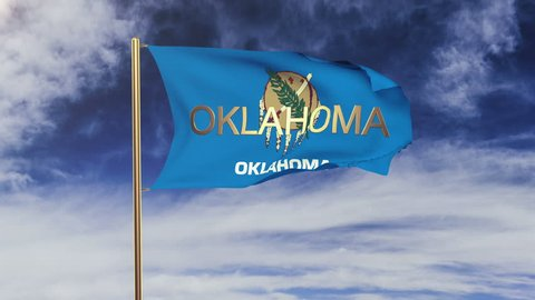 oklahoma flag with title waving in the wind. Looping sun rises style.  Animation loop