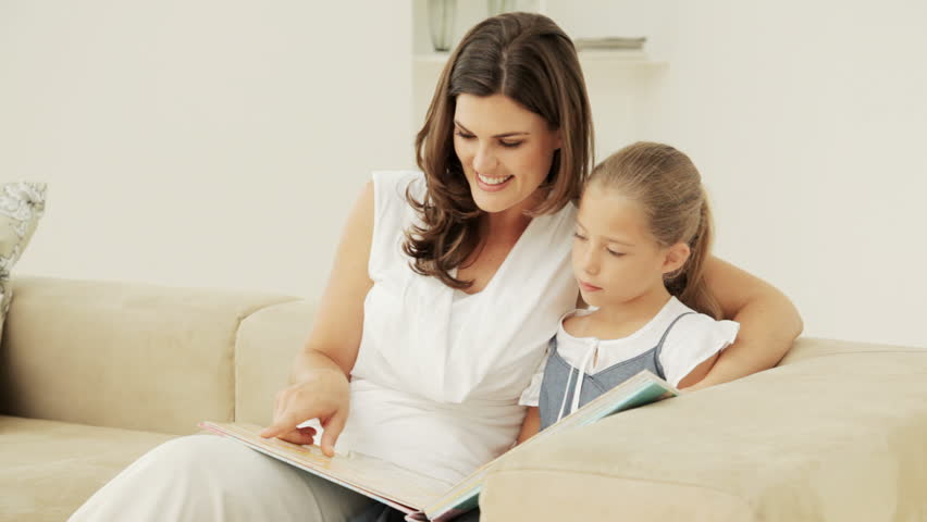 Mother and Daughter Reading Together on the couch    Shutterstock HD Video #927319