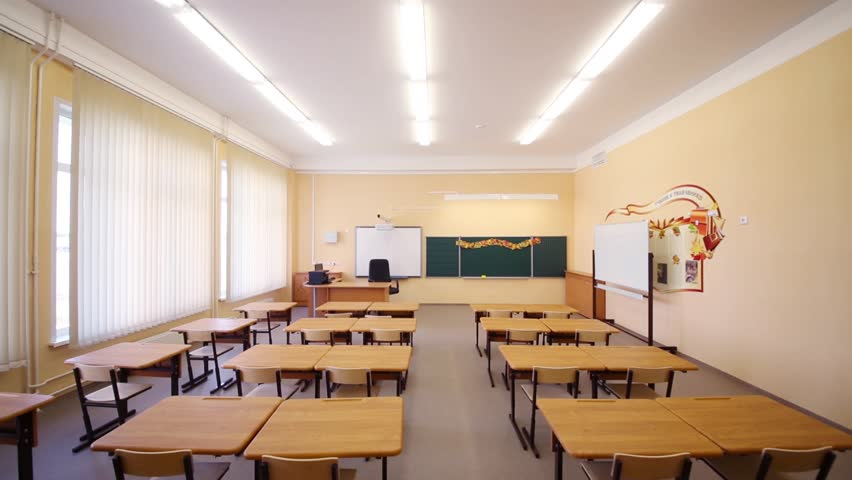 Modern Classroom Board ~ New modern school classroom with chairs on desks at sunny